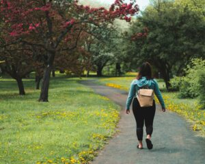 A girl out experiencing the health benefits of walking.